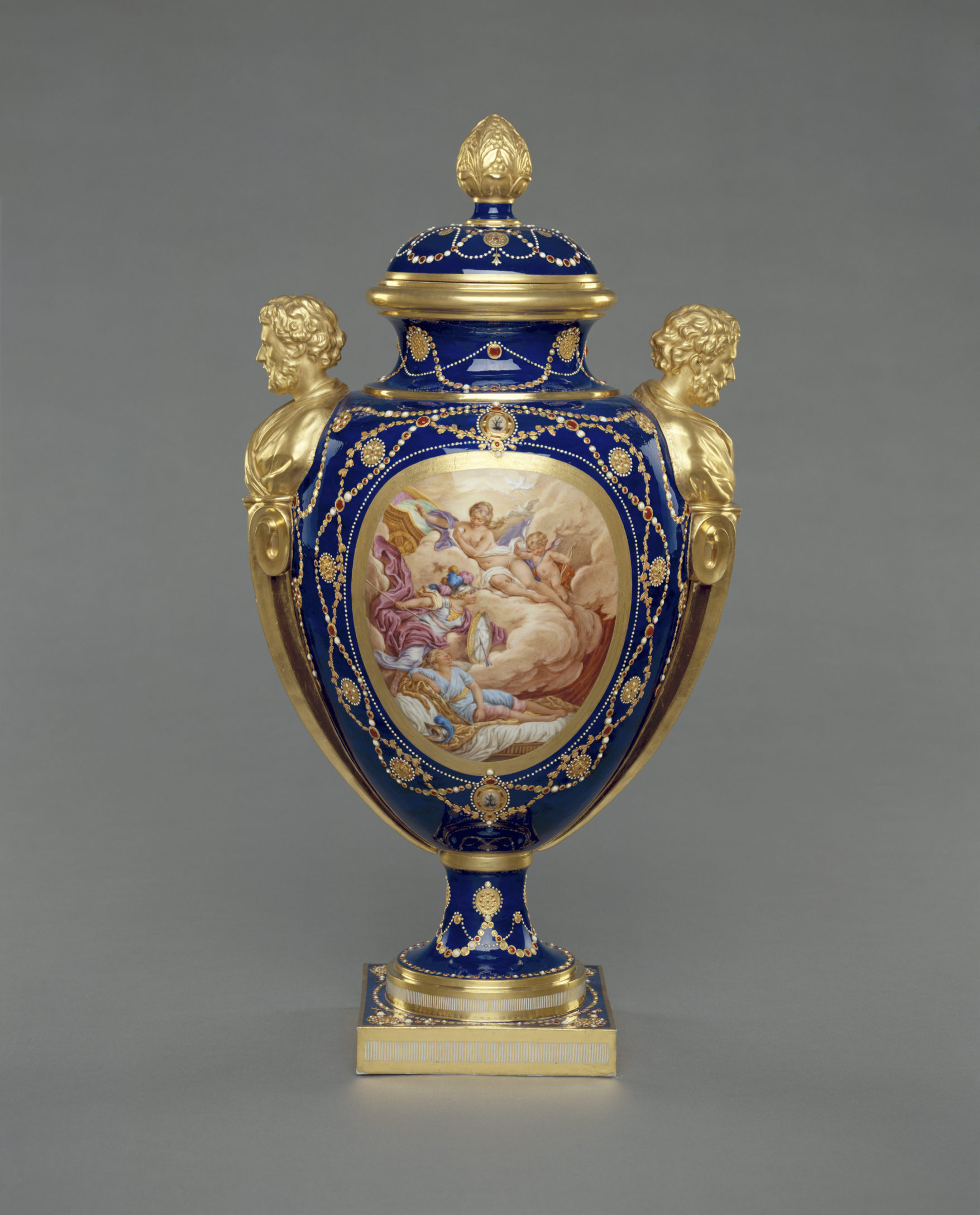 One of a garniture of three lidded, Sèvres 'vase des âges', 1781 with 'jewelling' by Philippe Parpette. (The J. Paul Getty Museum, Los Angeles, Inv. no. 84.DE.718.1-3)